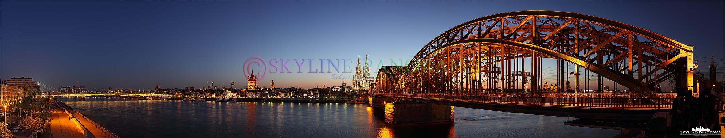 Die Kölner Skyline mit dem Kölner Dom aus der beliebtesten und wahrscheinlich auch bekanntesten Perspektive gesehen, dem Sockel der Hohenzollernbrücke vom gegenüberligendem Rheinufer.