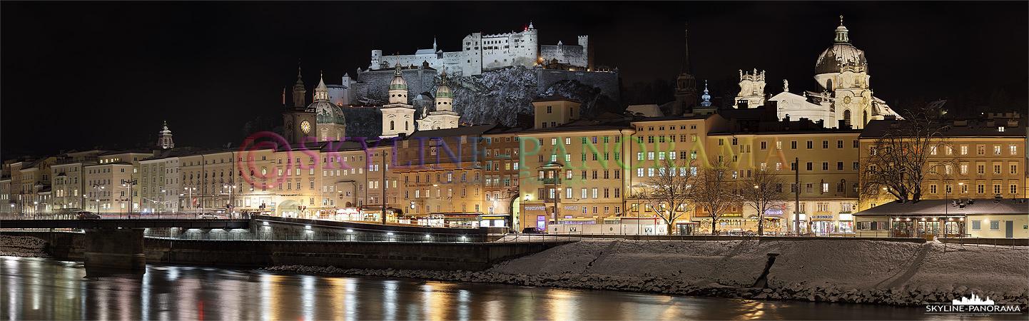 Panorama Salzburg - Die winterliche Silhouette der Salzburger Altstadt mit der Festung Hohensalzburg und dem Dom zu Salzburg vom Salzachufer aus gesehen.