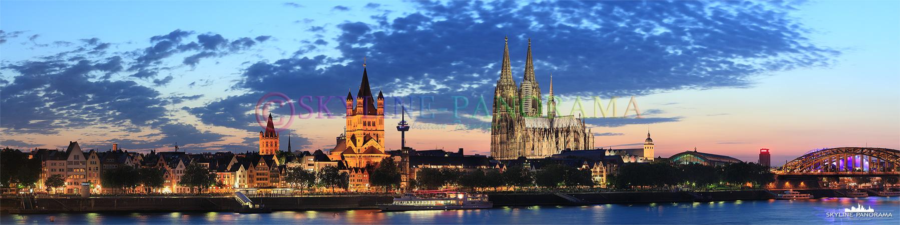 Bilder Köln - Das bekannte Köln Panorama zur Blauen Stunde mit dem wahrscheinlich schönsten Blick auf die Domstadt. Am Abend, kurz nach dem Sonnenuntergang, wenn die Beleuchtung am Kölner Dom eingeschalten wurde, zeigt sich die Skyline der Kölner Altstadt von seiner beeindruckenden Seite, der Dom strahlt dann als weithin sichtbares Wahrzeichen der Rheinmetropole.