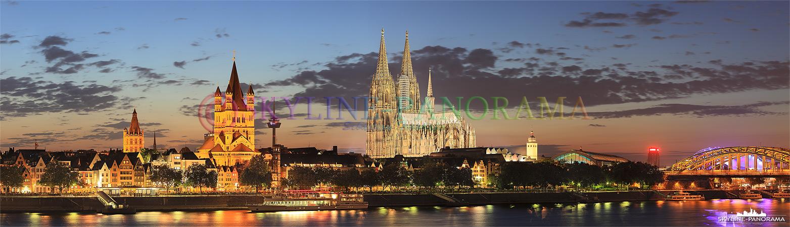 Die Kölner Skyline kurz nach dem Sonnenuntergang mit dem weithin sichtbaren Kölner Dom, dem Wahrzeichen der Stadt, im Zentrum. Der Dom ist das bekannteste historische Bauwerk der Rheinmetropole, er hat eine über 750 Jährige Geschichte und wurde erst Ende der 19. Jahrhunderts in seiner heutigen Form fertig gestellt.