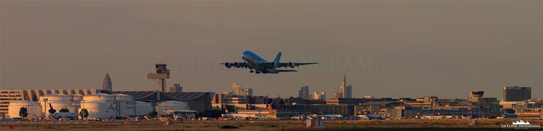 Airport Bilder - Start eines Airbus A380 der Fluggesellschaft Korean Air vom Frankfurter Flughafen in Richtung Seoul - Südkorea vor der Skyline von Frankfurt am Main zum Sonnenuntergang.