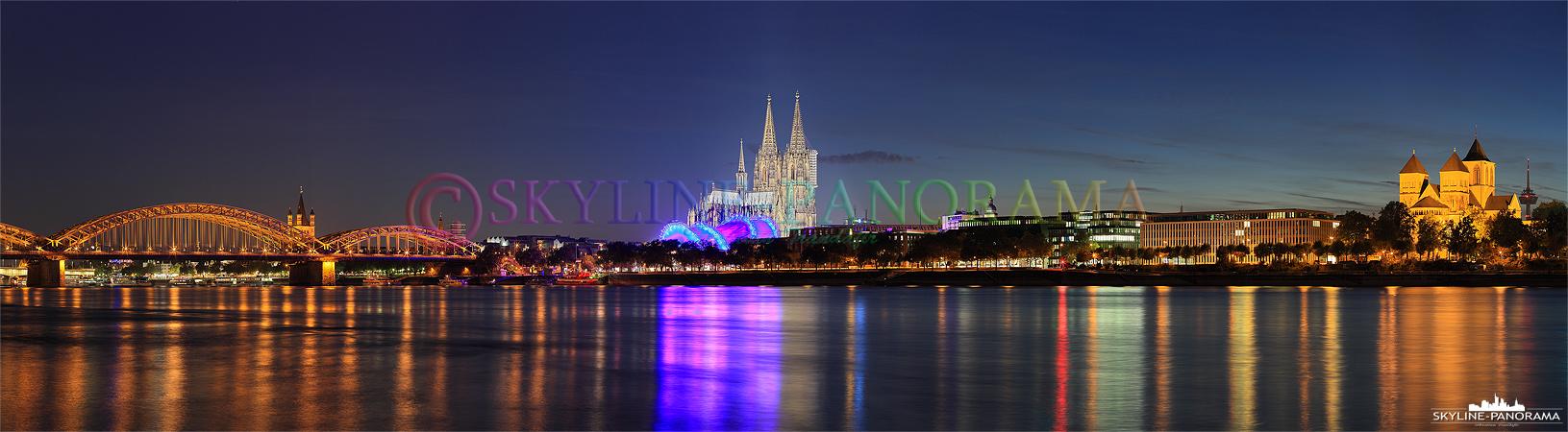 Kölner Dom zur Nacht - Das Köln Panorama mit dem alles überragenden Kölner Dom vom Rheinpark, zwischen der Hohenzollernbrücke und der Zoobrücke aus gesehen.