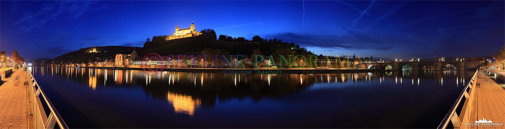 Bilder aus Würzburg - Panorama auf die hoch über Würzburg gelegene und hell erleuchtete Festung Marienberg am Abend.