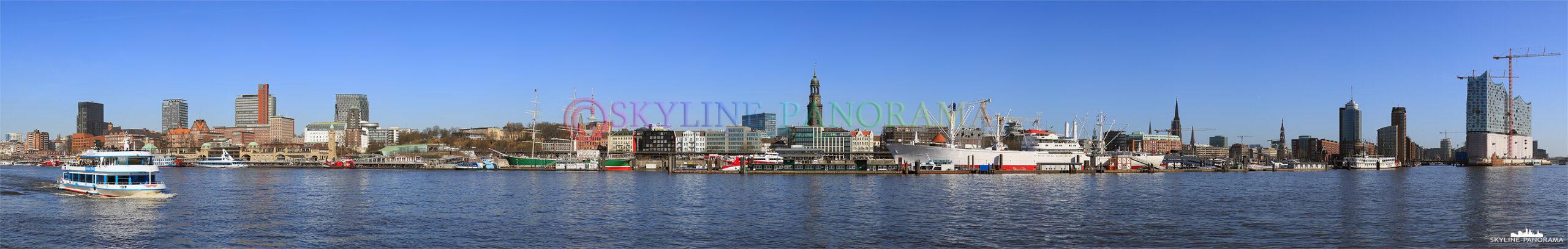 Bilder aus Hamburg - Die Hamburger Skyline mit den Landungsbrücken, dem Michel, der Speicherstadt und der Hafencity vom Elbufer aus gesehen.
