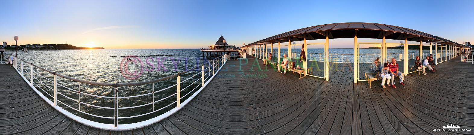 Ostsee Bilder - Auf der Seebrücke von Heringsdorf finden sich täglich zahlreiche Urlauber ein, um den Sonnenuntergang auf der Insel Usedom genießen zu können.