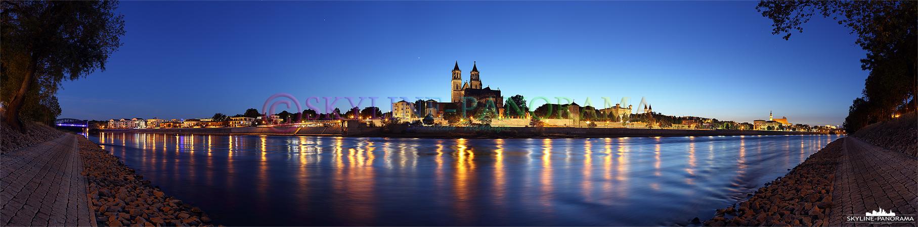 Bilder aus Magdeburg - Das abendliche Panorama vom Elbufer aus auf den Dom der Stadt Magdeburg.
