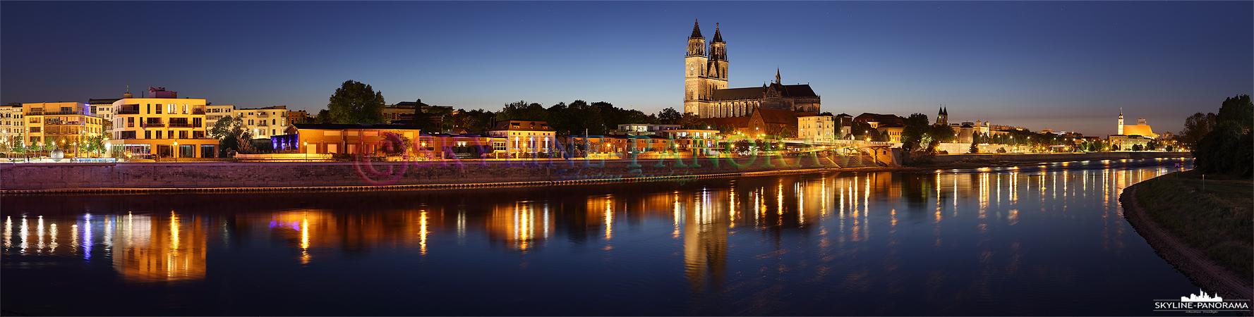 Bilder aus Magdeburg - Panorama der Magdeburger Skyline am Abend mit dem hell erleuchteten Dom von Magdeburg, der Landeshauptstadt von Sachsen-Anhalt.