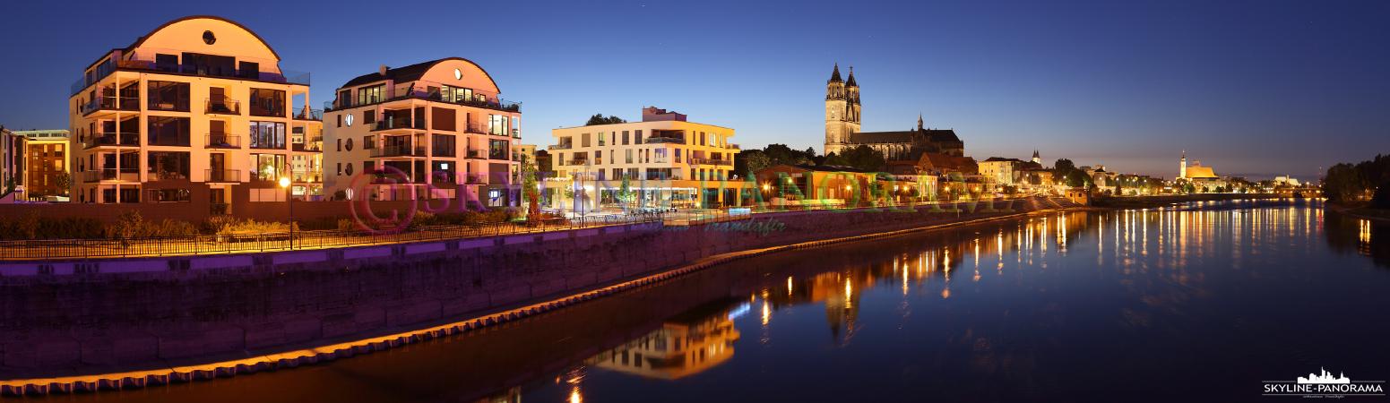 Bilder aus Magdeburg - Das abendliche Panorama der Stadtansicht Magdeburgs mit dem beleuchteten Dom von der Hubbrücke aus gesehen.