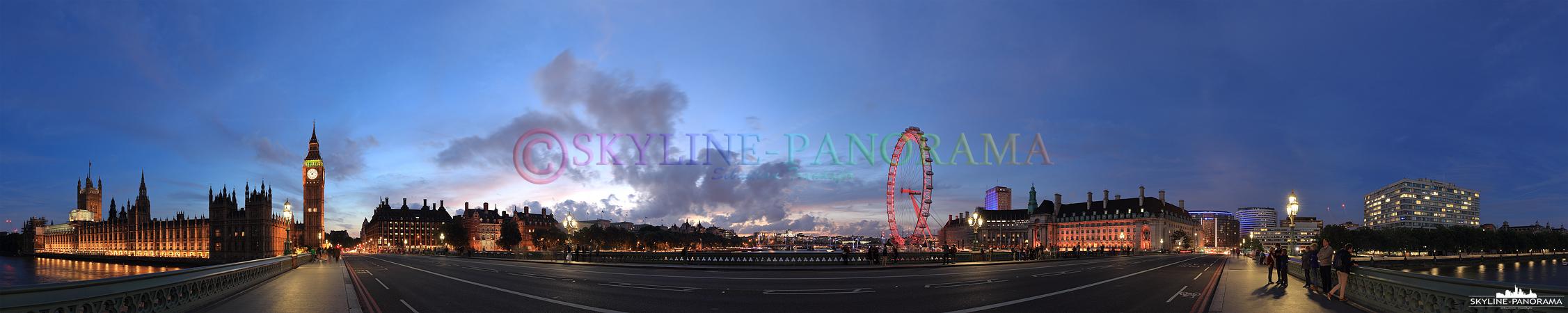 Bilder aus London – Das abendliche Panorama von der Westminster Bridge aus auf einige der bekanntesten Sehenswürdigkeiten von London, zu sehen sind der beleuchtete Palace of Westminster, Big Ben und das Riesenrad London Eye.