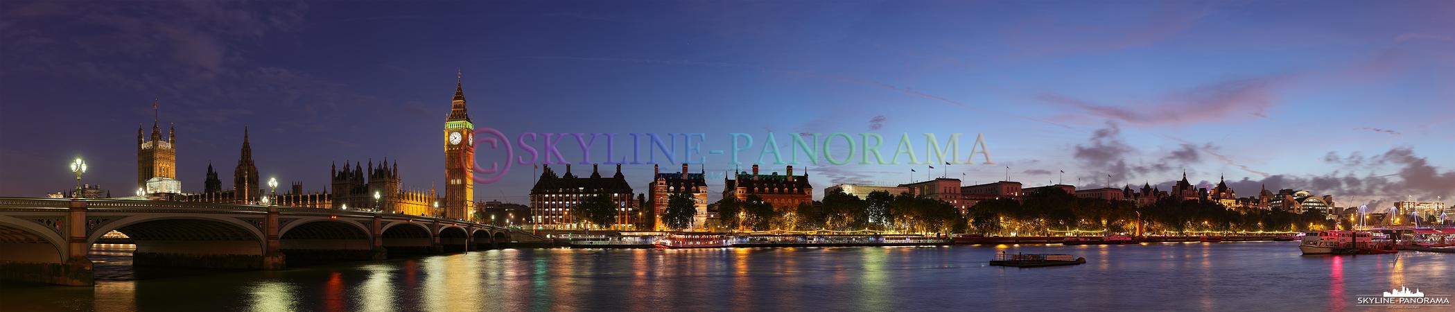 Bilder aus London - Panorama vom Themse Ufer auf den Londoner Stadtteil Westminster mit Blick auf die Westminster Bridge, dem dahinter liegenden Palace of Westminster und dem abendlich beleuchteten Glockenturm Big Ben.