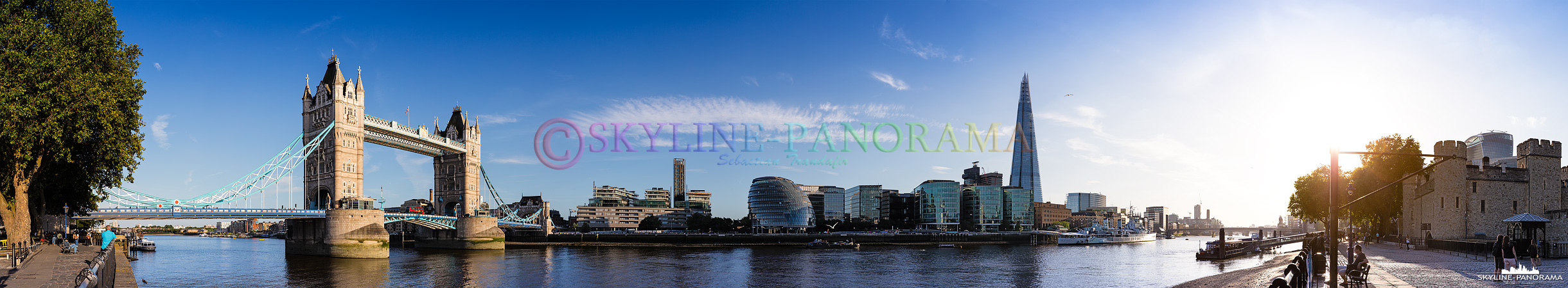 London am Tag - Die Skyline von London mit der historischen Tower Bridge, der Londoner City Hall und dem futuristischen Hochhaus The Shard vom Themse Ufer aus gesehen.