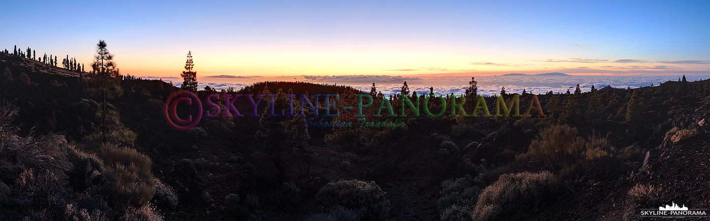 Panorama Teneriffa - Der Sonnenuntergang über der Wolkendecke im Teide Nationalpark auf der spanischen Insel Teneriffa.