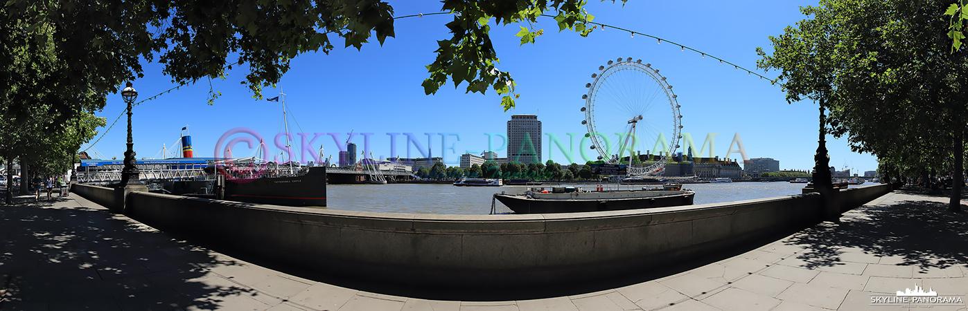 Bilder aus London - Die Uferpromenade der Themse im Stadtteil Westminster mit Blick auf das bekannte Riesenrad London Eye.