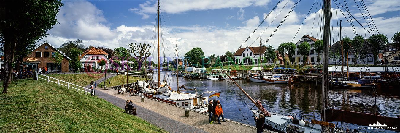 Nordsee Panorama - Der Hafen von Caroliniensiel mit seinen gemütlichen Cafes, Kneipen und Restaurants als Panoramaansicht.