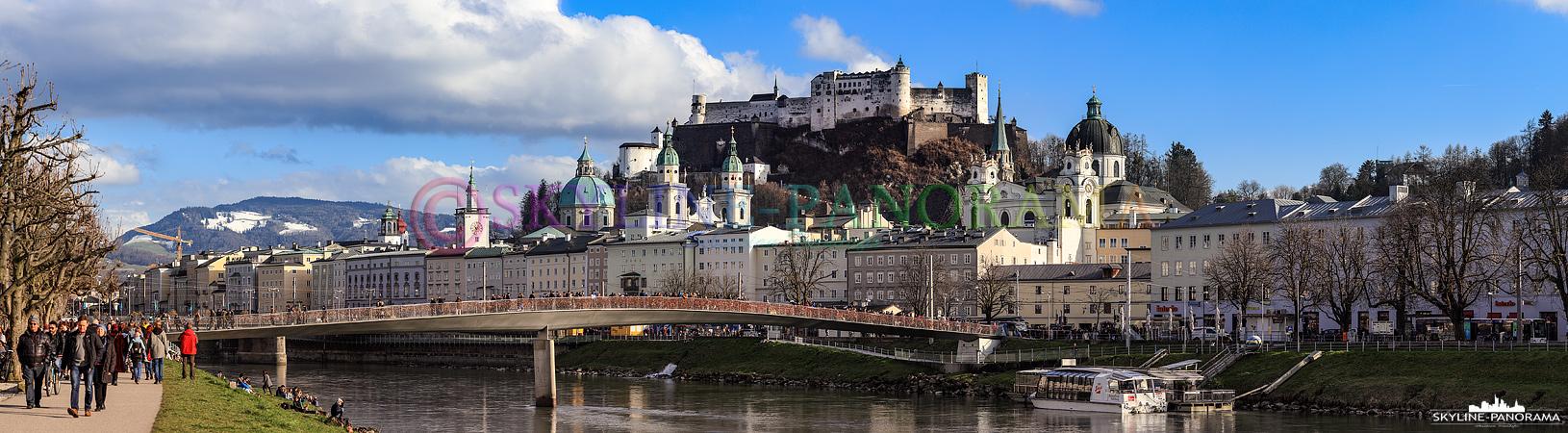 Salzburg am Tag - Panorama vom Elisabethkai am Ufer der Salzach in Richtung der Altstadt von Salzburg und der über alles thronenden Festung Hohensalzburg.