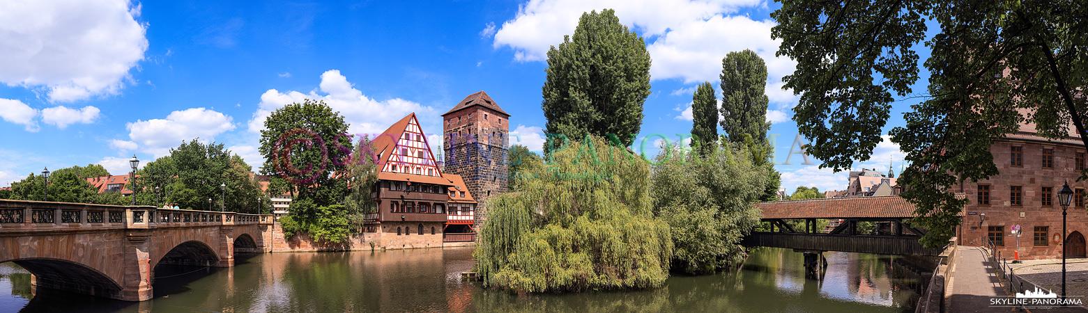 Altstadt von Nürnberg - Blick vom Ufer der Pegnitz aus auf den historischen Weinstadel, er wird linker Hand eingerahmt durch die Maxbrücke und den bekannten Henkersteg auf der gegenüberliegenden Seite.