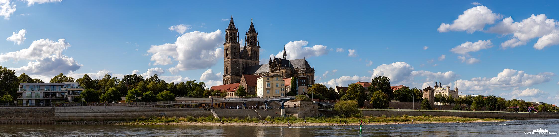 Stadtansichten von Magdeburg - Der Magdeburger Dom, als weithin sichtbares Wahrzeichen der Stadt, ist hier in einer Panoramaansicht vom Elbufer aus zu sehen.