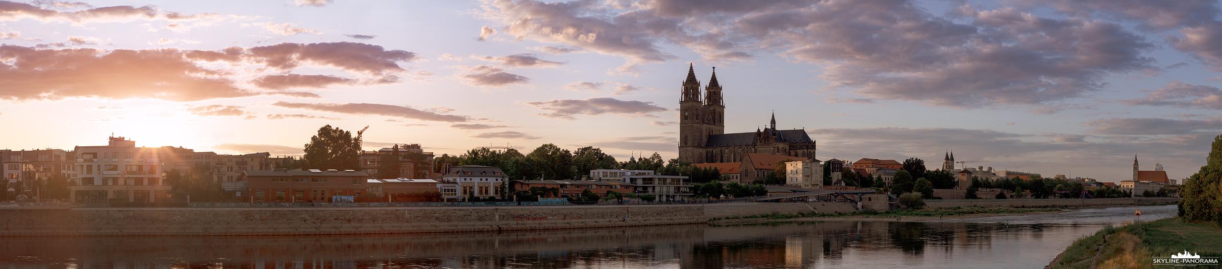 Panorama Magdeburg - Diese Stadtansicht von Magdeburg zeigt den Blick zum Sonnenuntergang vom Sockel der Hubbrücke aus, in Richtung des Magdeburger Doms. Das Motiv ist als Datei oder Fotodruck auf Leinwand, Alu oder hinter Acryl erhältlich.